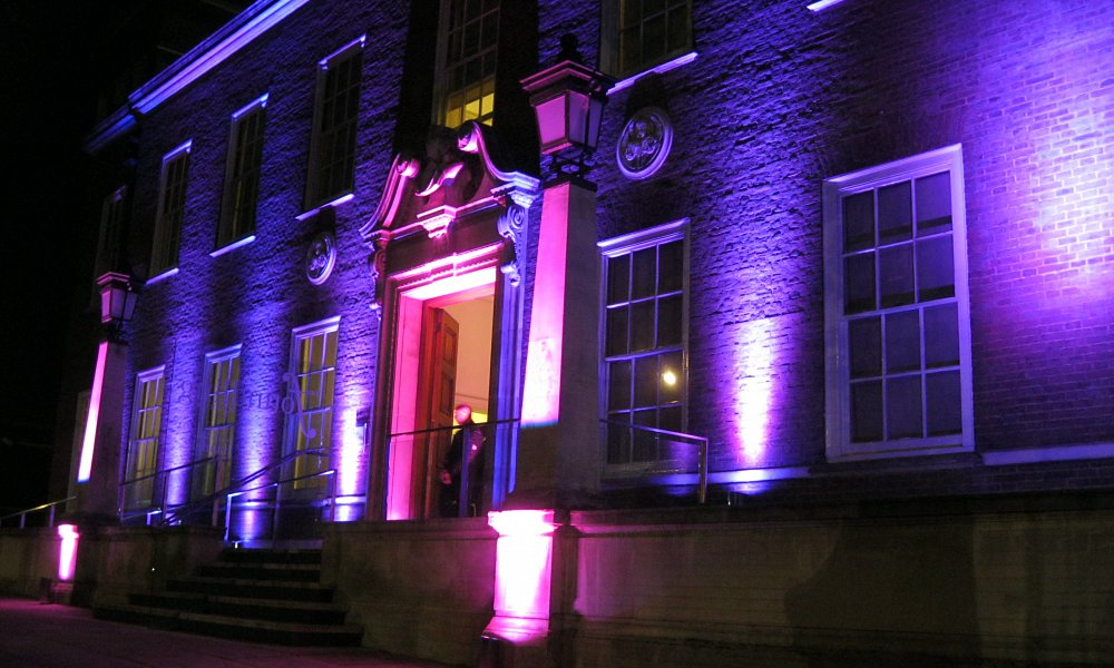 Exterior lit in pink and purple