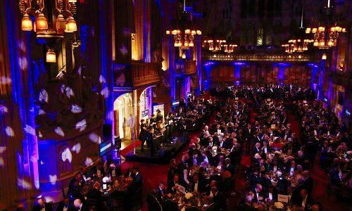 Transform the Iconic Guildhall in London with Screens for the Charity Auction, Pattern wash and battery uplighting which changes colour to match the sponsors throughout the evening