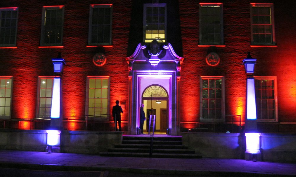 Foundling Museum at night with red and purple lighting