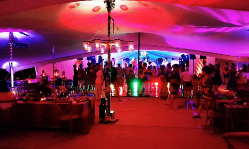 50th Birthday Party in a Marquee! breakup pattern wash, intelligent lighting to the stage and battery uplights combine together to create an intimate setting